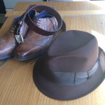 brown leather; brown hat